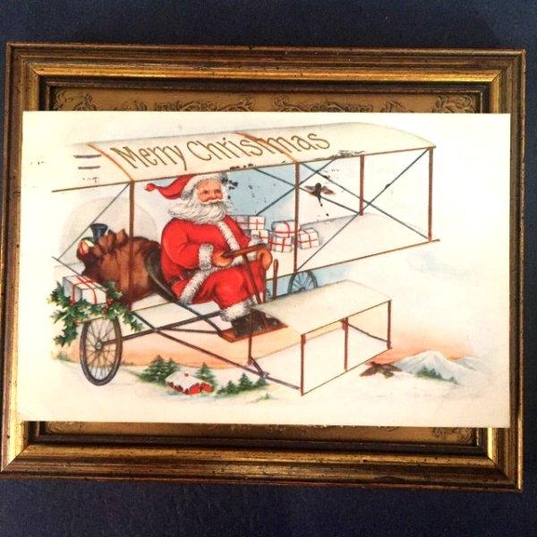 画像1: Postcard クリスマス 飛行機に乗ってプレゼントを配りに行くサンタクロース (1)