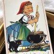 画像1: Postcard  お料理をしている魔女の女の子と黒猫 イギリス (1)